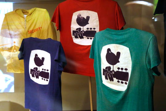"""A collection original 1969 Woodstock Festival t shirts on display for the show, """"We Are Golden"""" at Bethel Woods Center for the Arts on March 28, 2019."""