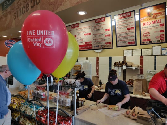 Jersey Mike's employees make subs during the Day of Giving on Wednesday, during which all sales were donated to United Way of Franklin County.