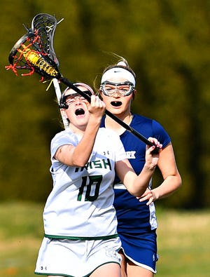 York Catholic's Sydney Mentzer carries the ball during girls' lacrosse action against West York at York Catholic High School in York City, Thursday, March 28, 2019. York Catholic would win the game 23-3. Dawn J. Sagert photo