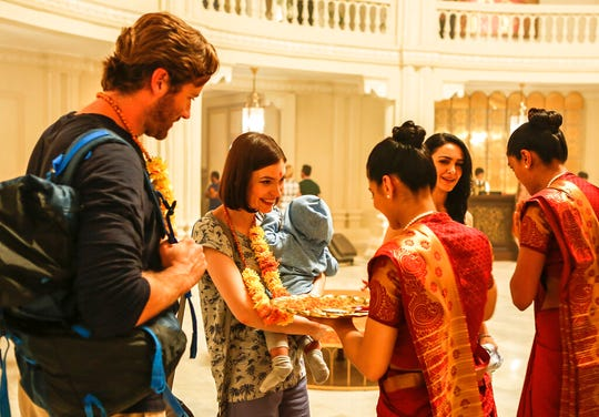 """From left,  Armie Hammer, Tilda Cobham-Hervey and Nazanin Boniadi in a scene from """"Hotel Mumbai."""" The movie is playing at R/C Hanover Movies."""