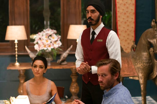 """From left, Nazanin Boniadi, from left, Dev Patel and Armie Hammer in a scene from """"Hotel Mumbai."""" The movie is playing at R/C Hanover Movies."""