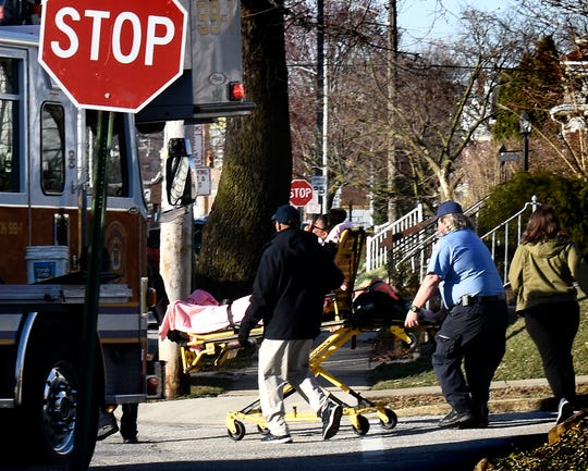 Paramedics move a patient to an ambulance after a school bus crash at the intersection of Maryland and Belvidere avenues in York City Thursday, March 28, 2019. The bus was transporting students from the high school to the Edgar Fahs Smith STEAM Academy when it was involved in a crash. Six William Penn High School students were taken to the hospital with injuries. Bill Kalina photo