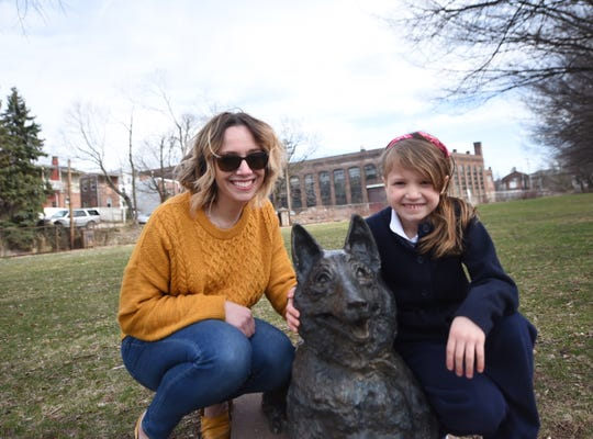Meagan Given, left, and her daughter, Holden Feeser, pose with the statue of Pal. The two are helping orchestrate a fundraising effort to repurpose a near-acre-sized lot into a dog park. The site is near the King Street intersection of the Heritage Rail Trail. Pal's Park would be named after a WWII Marine dog .