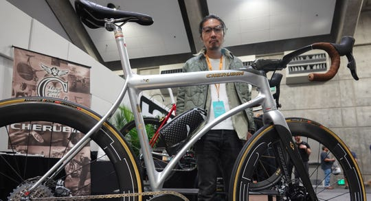 Builder Shinichi Konno of Cherubim Cycles of Tokyo shows off his work at the North American Handmade Bicycle Show in Sacramento, Calif., in March, 2019.