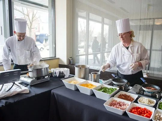 Chefs at the Strathallan's Char Steak and Lounge restaurant, Dave Moscowitz of Brighton and Cindi Herman of Chili, prepare their stations during a Sunday brunch buffet in 2016.