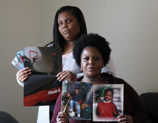 Shonday Williams and her mother Lisa Williams hold  photos of Plush Dozier. Dozier's mother and sister are worried that his transfer from the Genesee County Jail to Attica Correctional Facility as a pretrial inmate has affected his mental heath.