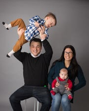 Reporter Victoria Freile with her husband Jody Sebastiano and sons Joe (in air) and Luke.
