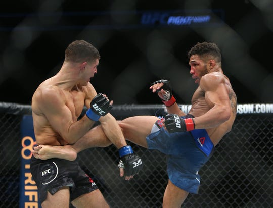 Kevin Lee, right, kicks Al Iaquinta during a fight in Milwaukee on Dec. 15, 2018. Lee faces former UFC lightweight champ Rafael dos Anjos in Rochester on May 18.