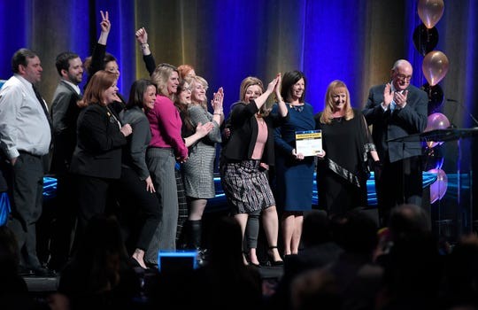Reliant Community Federal Credit Union receives an Ambassador Award during the 2019 Top Workplaces Award Ceremony at the Rochester Convention Center, Wednesday, March 27, 2019.