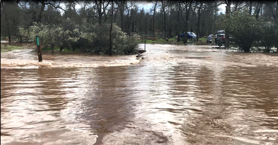 Old Oasis Road in north Redding was completely flooded in the afternoon on March 27 following an intense rain and hail storm.
