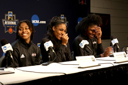 Mississippi State players, Jazzmun Holmes, Anriel Howard and Teaira McCowan joke around during a press conference prior to the NCAA Women's Regional at the Moda Center in Portland on March 28, 2019.
