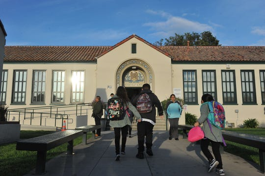 Children run to class at Salinas' Roosevelt Elementary School, where close to a third of students were identified as homeless, according to district data.