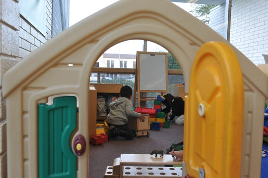 Children play at Steinbeck Public Library in Salinas on March 27, 2019.