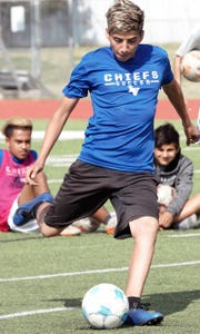 Lake View's Luis Negrete takes a shot during soccer practice at Lake View on Wednesday, March 27, 2019.