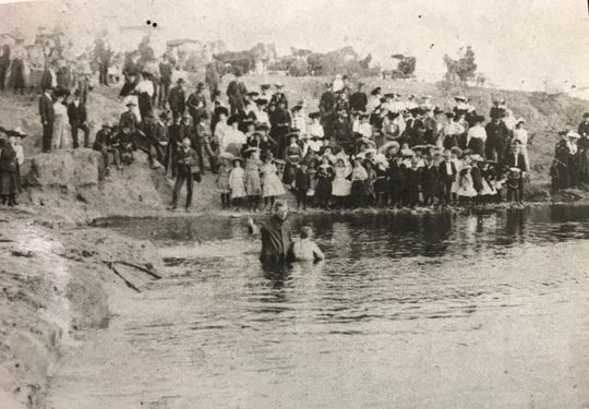 T.B. Larimore baptizes in the Concho River in 1903.