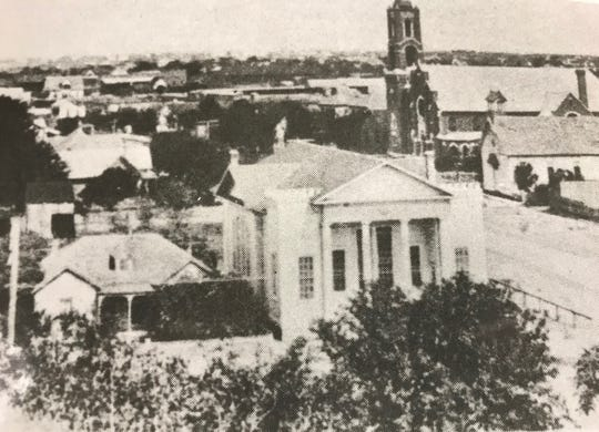 Harris and Irving Street Church of Christ as it appeared in 1909 from the upper story of the Tom Green Co. Courthouse. The tall tower of First Presbyterian can beseen behind the church.