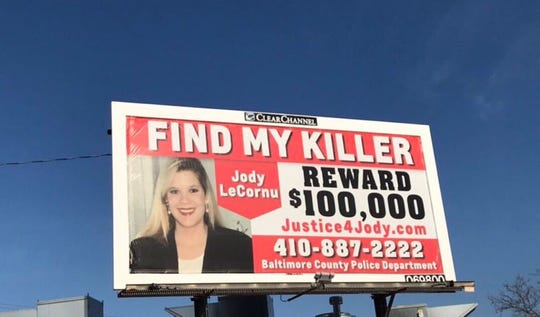 """A billboard in Baltimore shows the face of Jody LeCornu, who was killed in Baltimore 23 years ago. Her twin sister, Jenny Carrieri, recently put up these billboards to spread the story of the unsolved murder. """"I feel like I'm so close,"""" she said on Monday, March 25, 2019."""