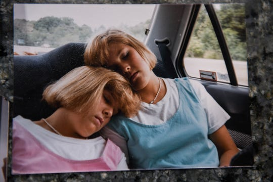 """Jenny Carrieri is pictured as a child with twin sister, Jody LeCornu, who was killed in Baltimore 23 years ago. Carrieri said at times she's been consumed with trying to find her sister's killer. """"I've just put every part of me into it,"""" she said on Monday, March 25, 2019."""