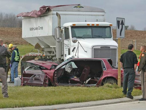 Sheboygan County Sheriff's deputies investigate an accident Monday Nov. 5, 2007 after a grain truck and car collided at state Highway 23 and county Highway TT. Press photo/Bruce Halmo
