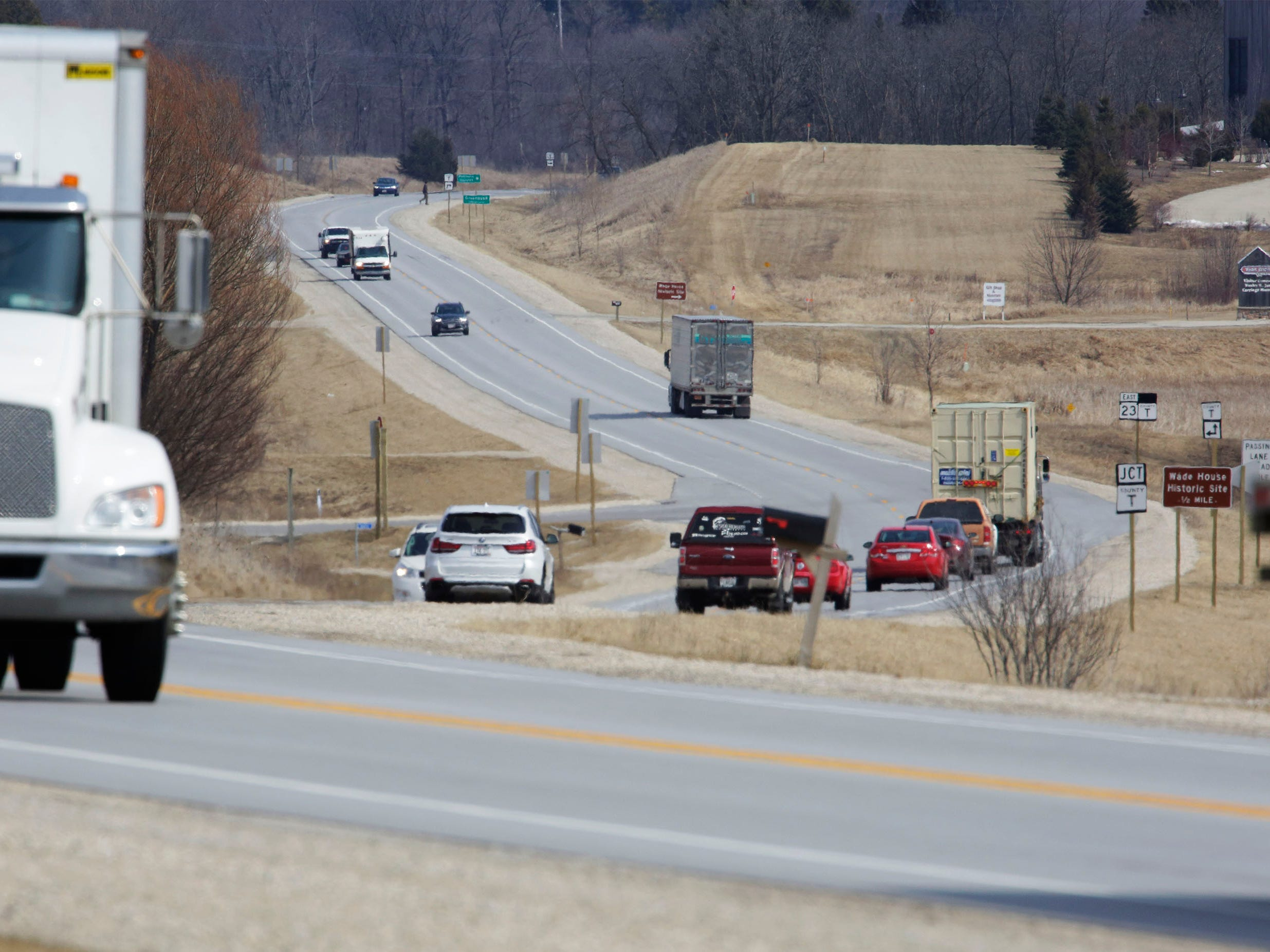 Trucks and cars travel on state Highway 23, Wednesday, March 27, 2019, near Greenbush, Wis.