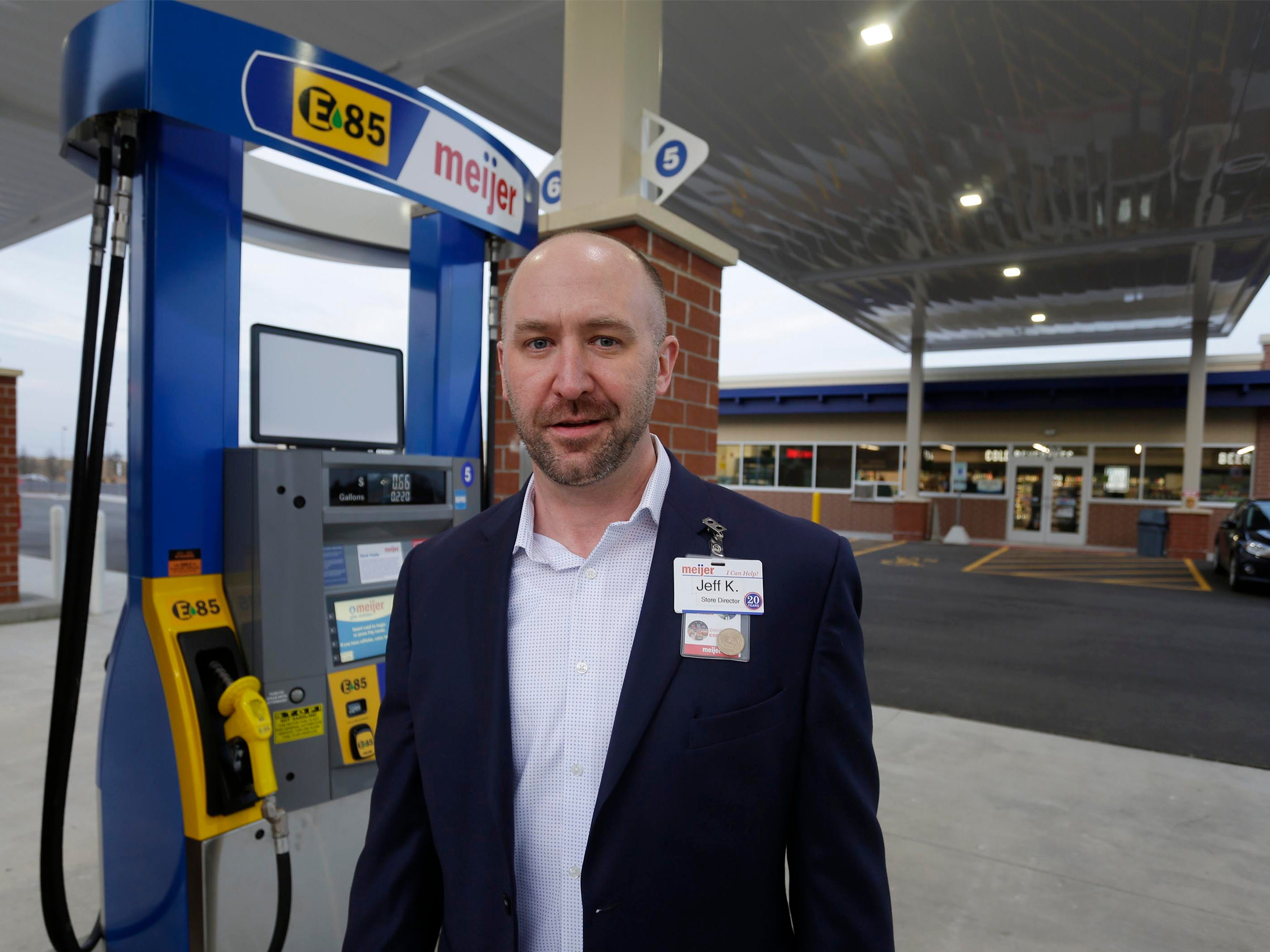 Meijer Store Director Jeff Kietzman poses by a fuel pump at the new Meijer gas station, Thursday, March 28, 2019, in Sheboygan, Wis.