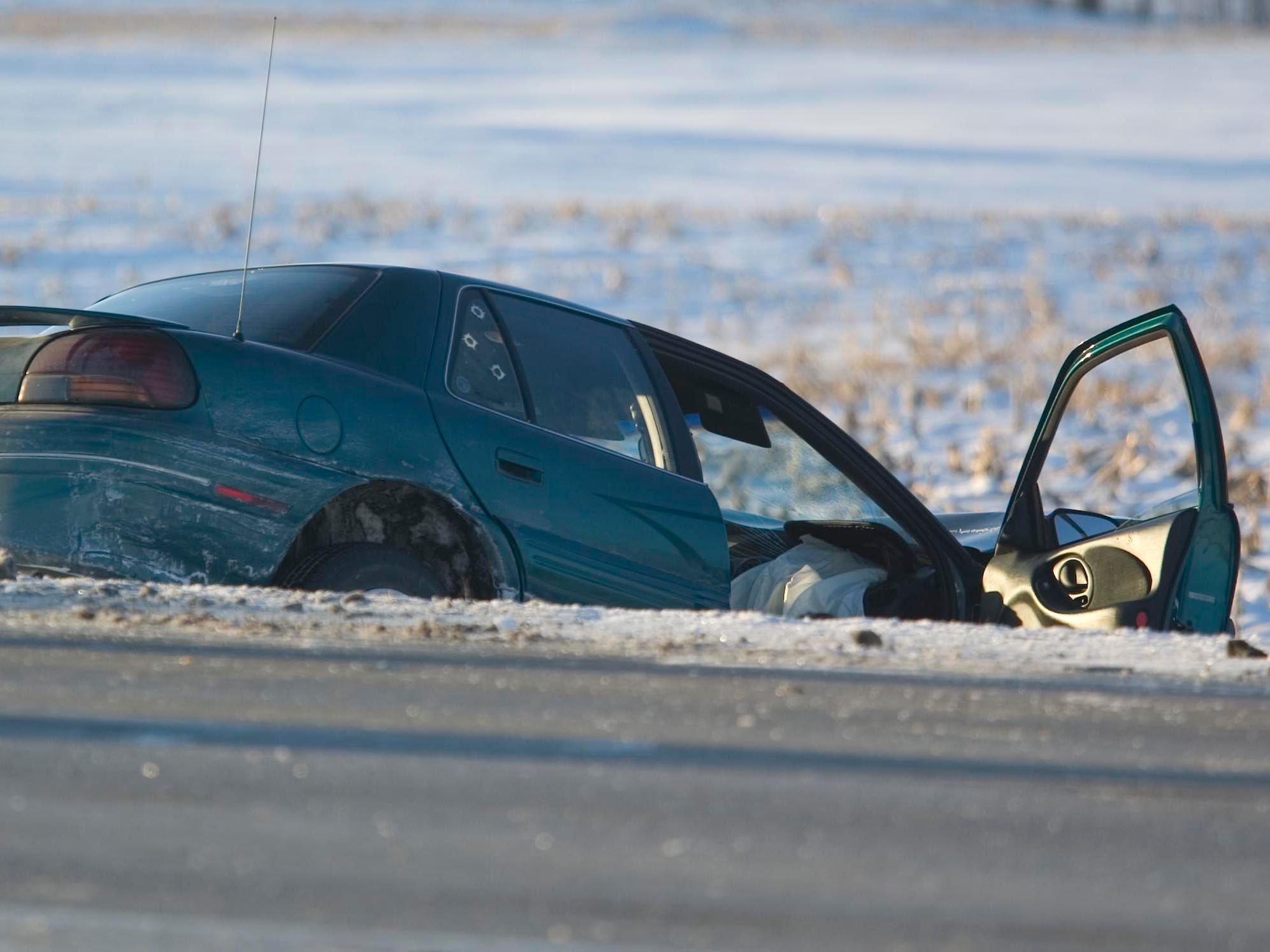 A vehicle involved in the multiple car collision Friday January 16, 2009 at state Highway 23 and County U sits in a ditch at the scene. Officials closed a section of state Highway 23 to take care of the crash. Photo by Gary C. Klein/The Sheboygan Press