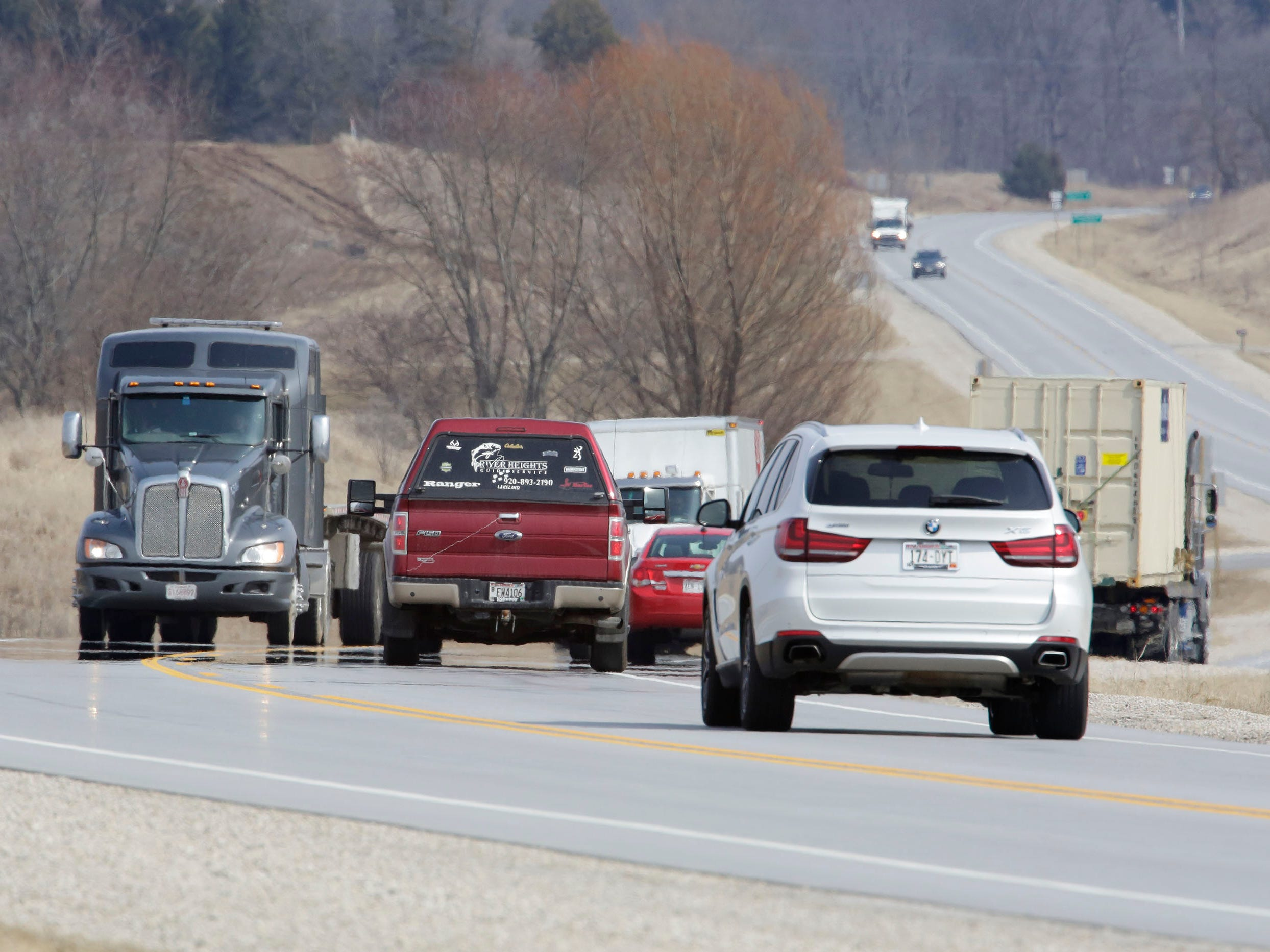 Vehicles travel on state Highway 23, Wednesday, March 27, 2019, near Greenbush, Wis.