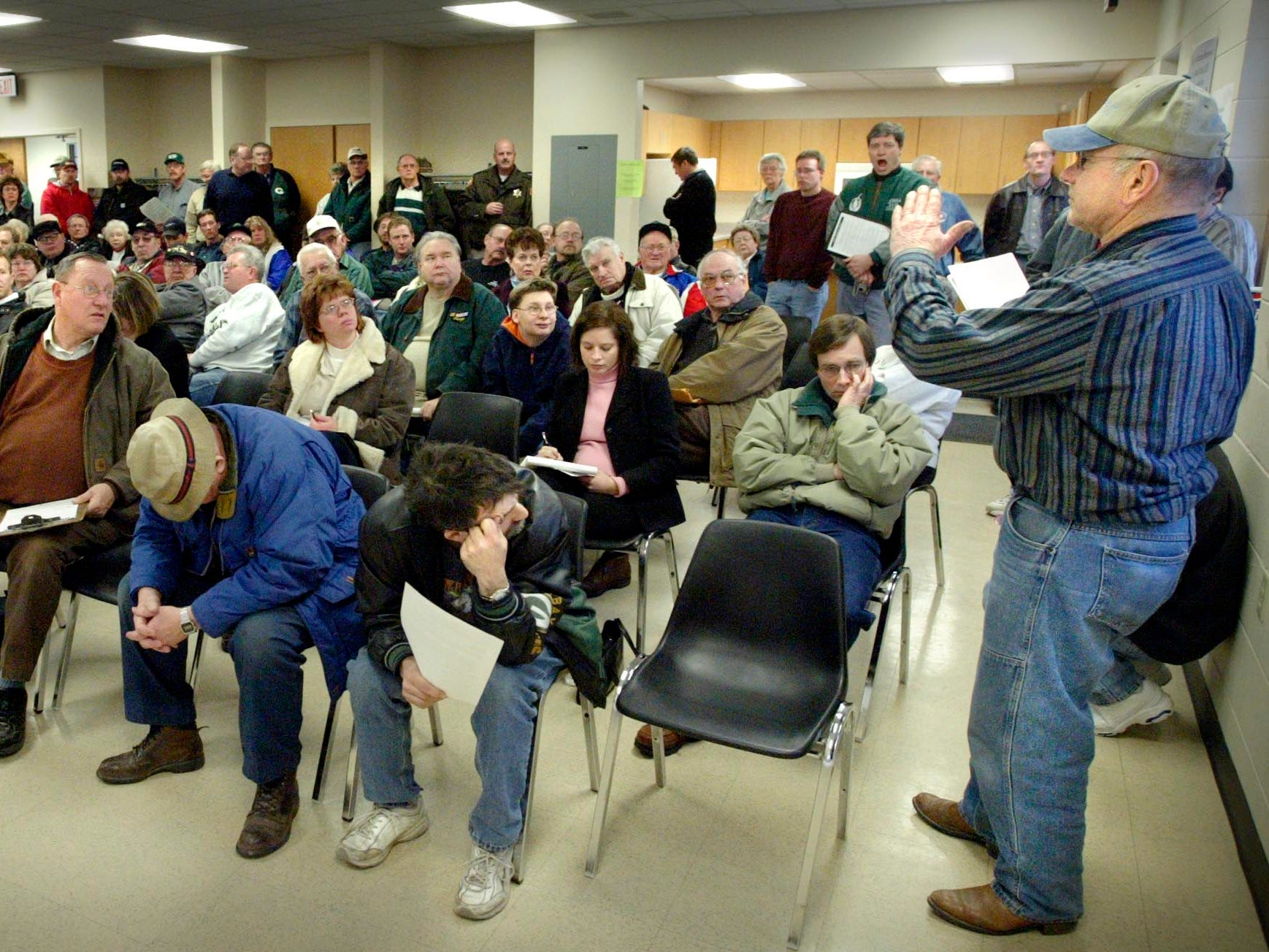 Farmer Merlin Limberg, right, expresses his concerns Wednesday about the expansion of state Highway 23 during a DOT public hearing January 5, 2005, at the Greenbush, Wis. Village Hall.