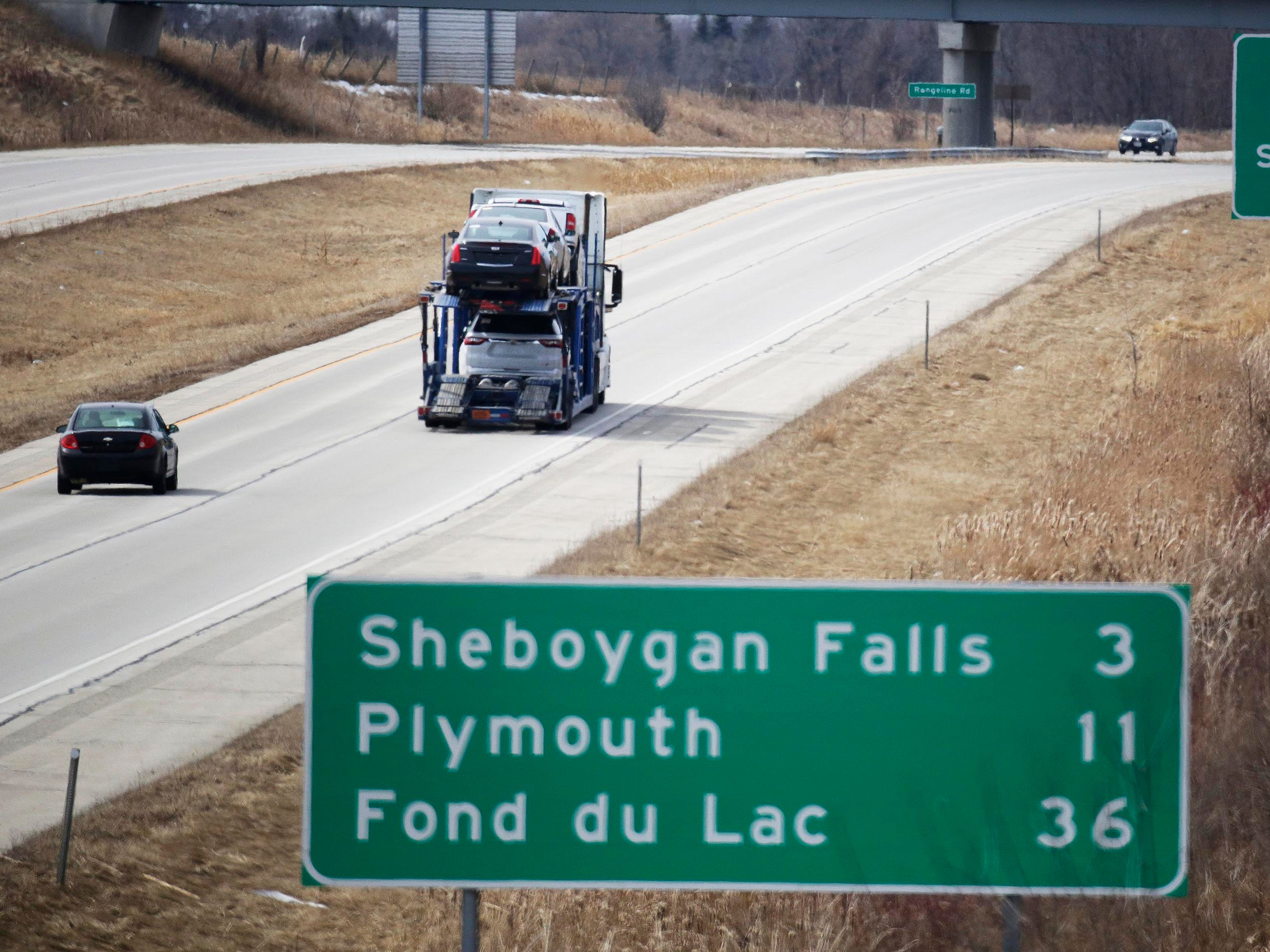 Vehicles travel westbound on state Highway 23, Wednesday March 21, 2018, in Kohler, Wis. The Wisconsin State Patrol says it is going to increase law enforcement on the road.