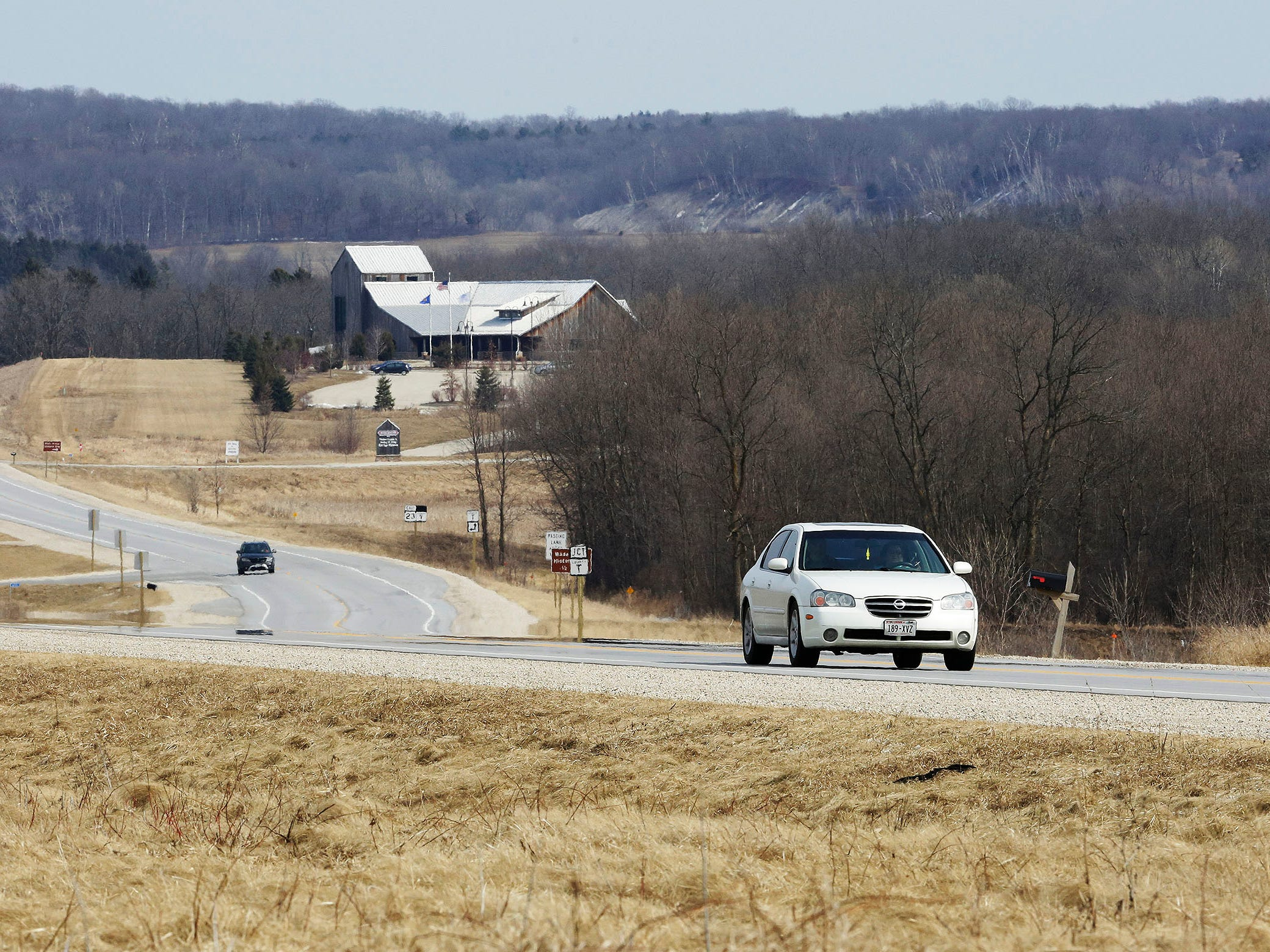 A vehicle travels west near the Wade House Historic site along state Highway 23, Wednesday, March 27, 2019, near Greenbush, Wis.