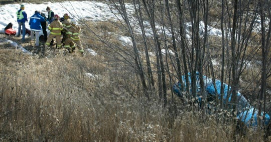 Emergency workers tend to a victim of a two-vehicle accident on State 23 and Meadowlark Road near Sheboygan, Wis.