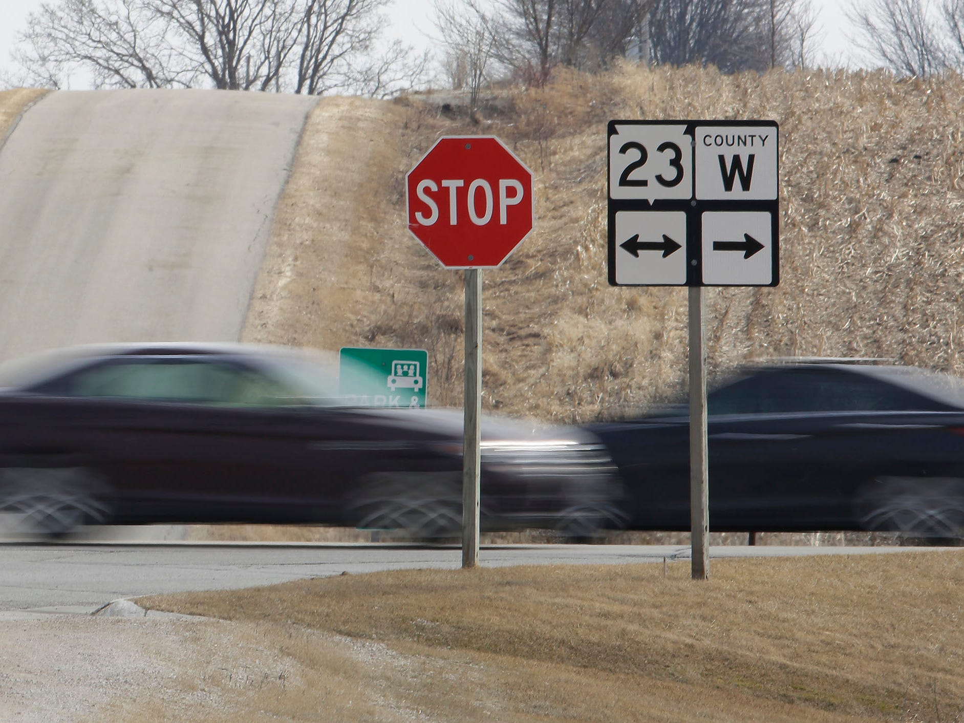 Vehicles are a blur of travel on state Highway 23, Wednesday, March 27, 2019, near St. Cloud, Wis.  The state said it will start construction on the highway to develop the road as four-lane highway between Sheboygan and Fon du Lac.