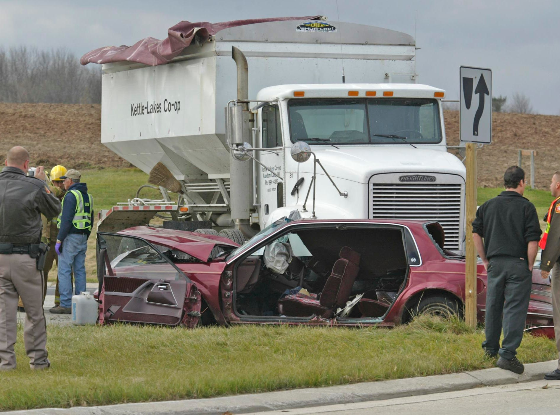 Sheboygan County Sheriff's deputies investigate an accident, Monday, Nov. 5, 2007, after a grain truck and car collided at state Highway 23 and county Highway TT.