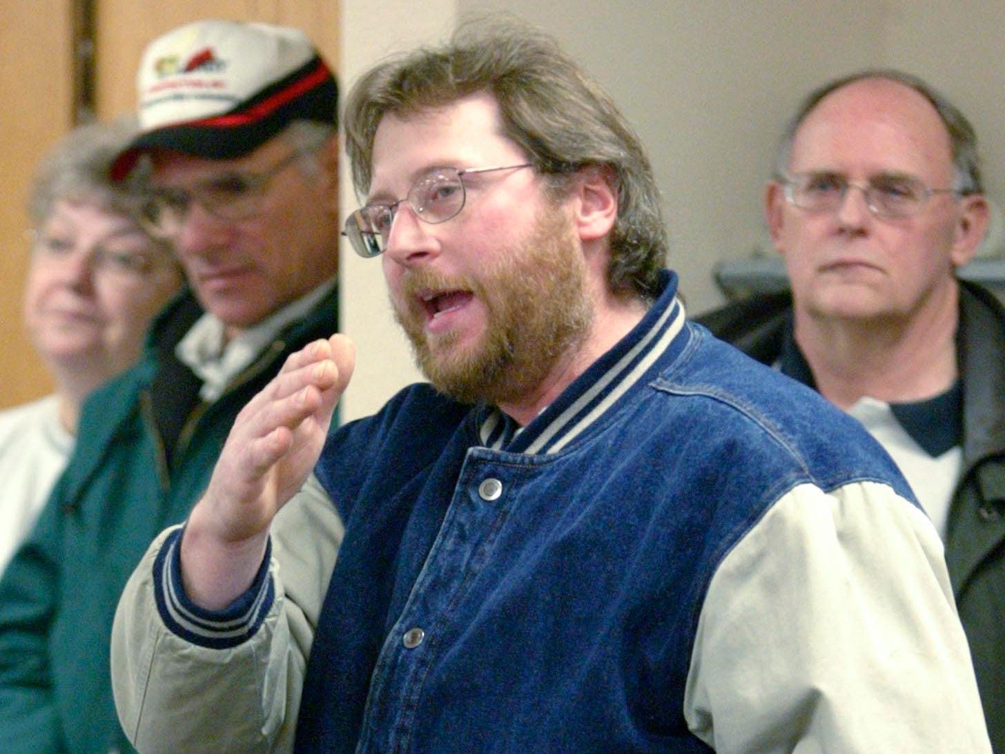 Farmer Gary Kraus expresses his concerns Wednesday about the expansion of state Highway 23 during a DOT public hearing Januaery 5, 2005, at the Greenbush, Wis. Village Hall.
