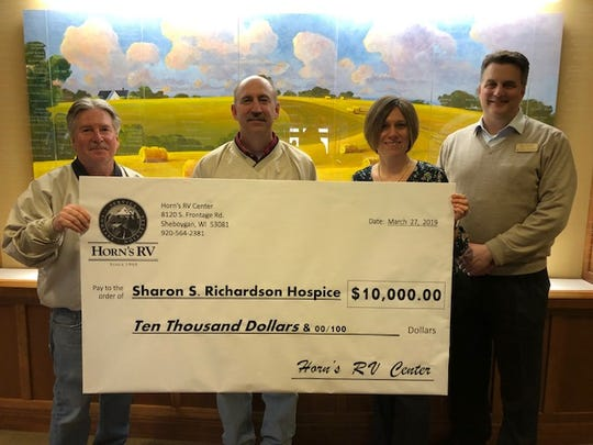 Greg Horn and Jim DePagter of Horn's RV Center, Charmaine Conrad and Eric Tetzlaff of Sharon S. Richardson Community Hospice