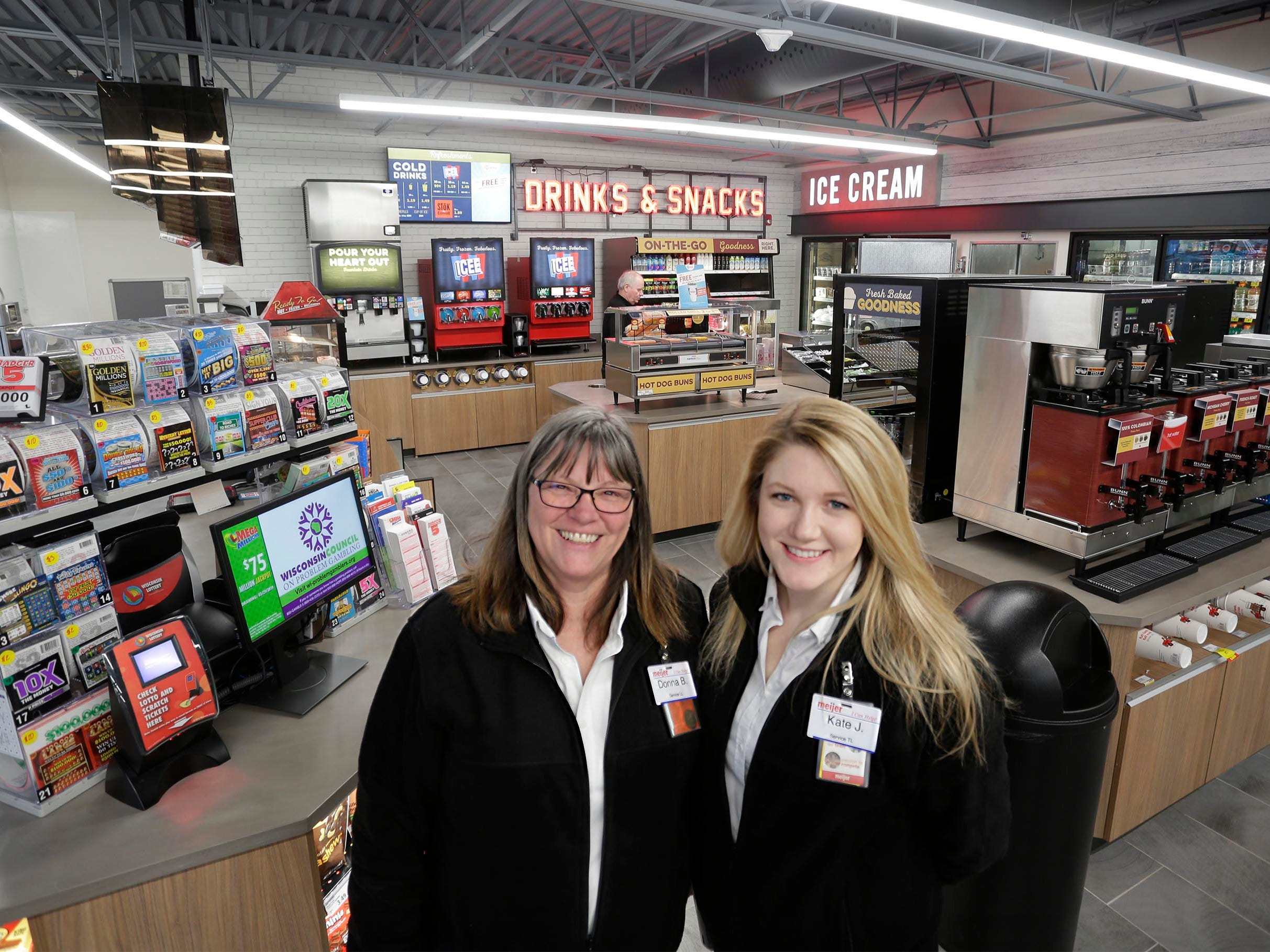 Meijer employees Donna Benzow, left, and Kate Joy pose inside the new Meijer Gas Station store, Thursday, March 28, 2019, in Sheboygan, Wis. The nearby Meijer supercenter is slate to open Sunday, April 28, 2019.