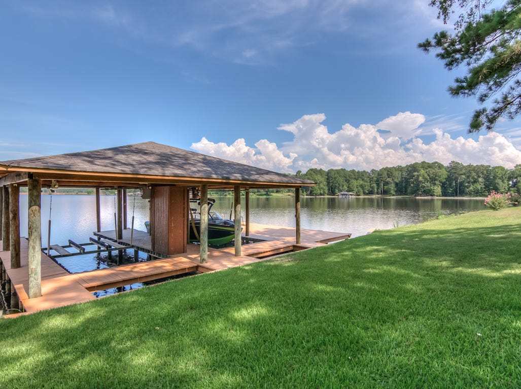 395 Jessie Jones Drive, Benton  Price: $1,300,000  Details: 4 bedrooms, 6 bathrooms, 4,600 square feet  Features: Log cabin home on over 4.5 acres with 450 feet of shoreline on Cypress Lake, 25 ft. floor to ceiling sandstone fireplace, 112-year-old antique pine floors, media room, office, sunroom, boat house with lifts, 3 car garage, trophy room.   Contact: Jeff Wyatt 423-8468