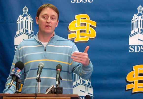 Aaron Johnston announces at a 2007 press conference that he turned down the coaching position at Wisconsin-Green Bay.