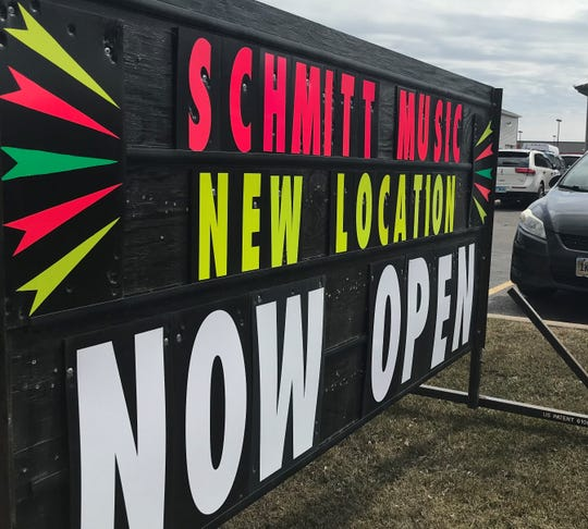 A sign on West 41st Street alerts customers to Schmitt Music's new Sioux Falls location. The store signed a two-month lease after flooding damaged its old space near Cliff Avenue and East 41st Street.