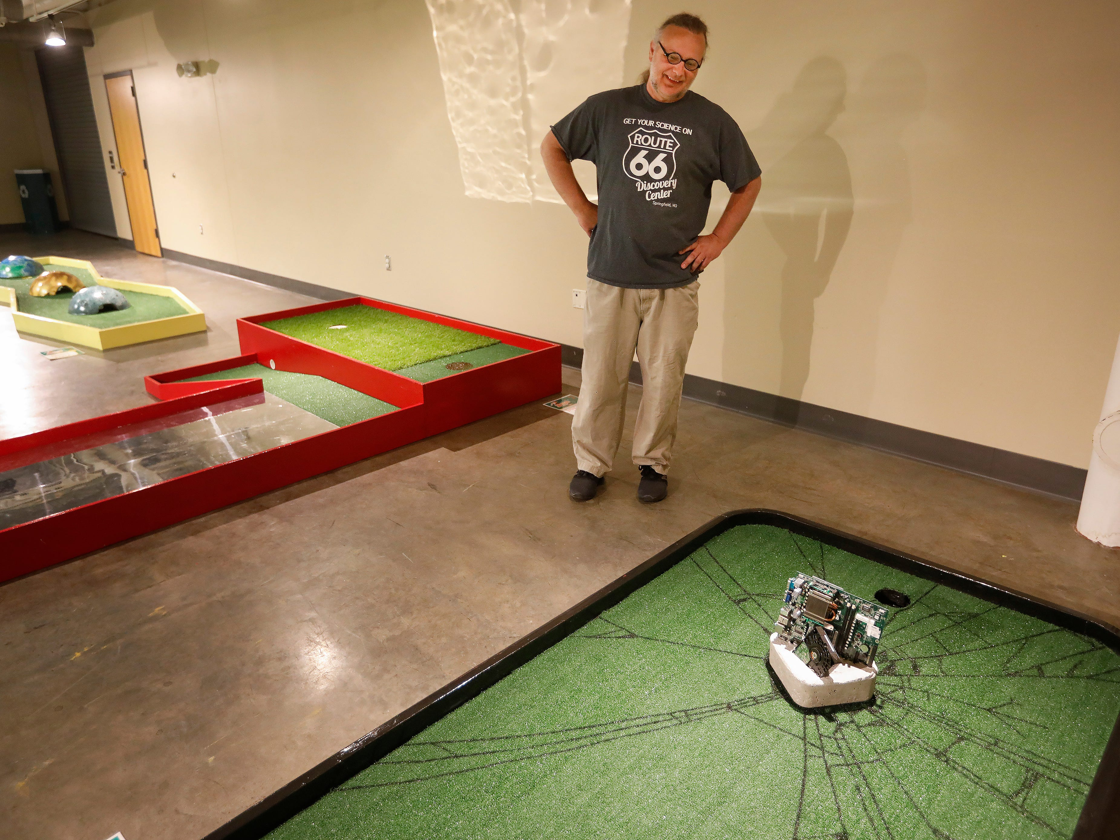 Robert Olson, exhibits director at the Discovery Center, talks about designing the new 9-hole indoor miniature golf course at the science museum. The new exhibit opens to the public on Sunday, March 31, 2019.
