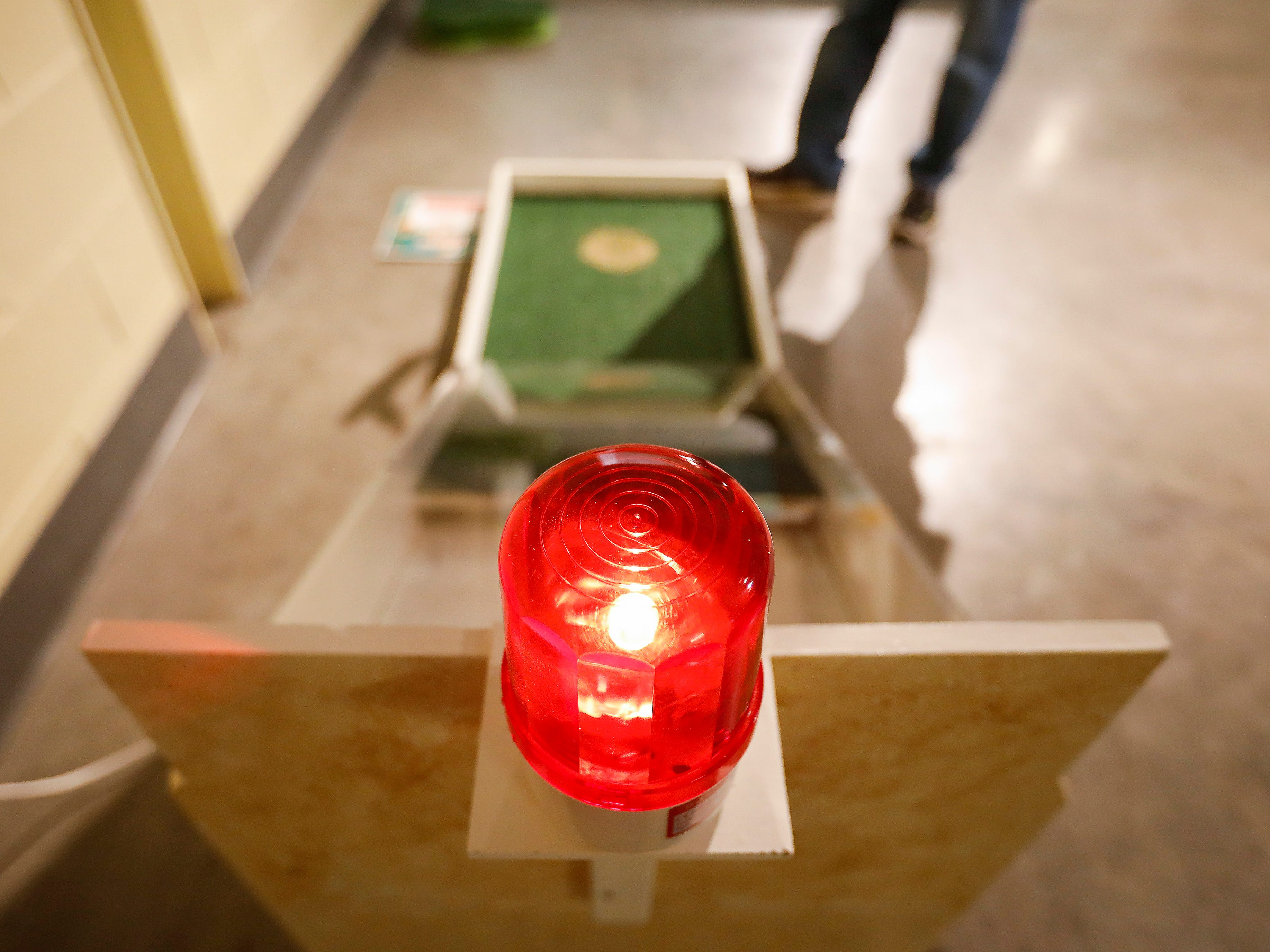 Steve Pokin sets off the alarm after sinking a hole-in-one on the final hole of the new 9-hole indoor miniature golf course at the Discovery Center. The new exhibit opens to the public on Sunday, March 31, 2019.