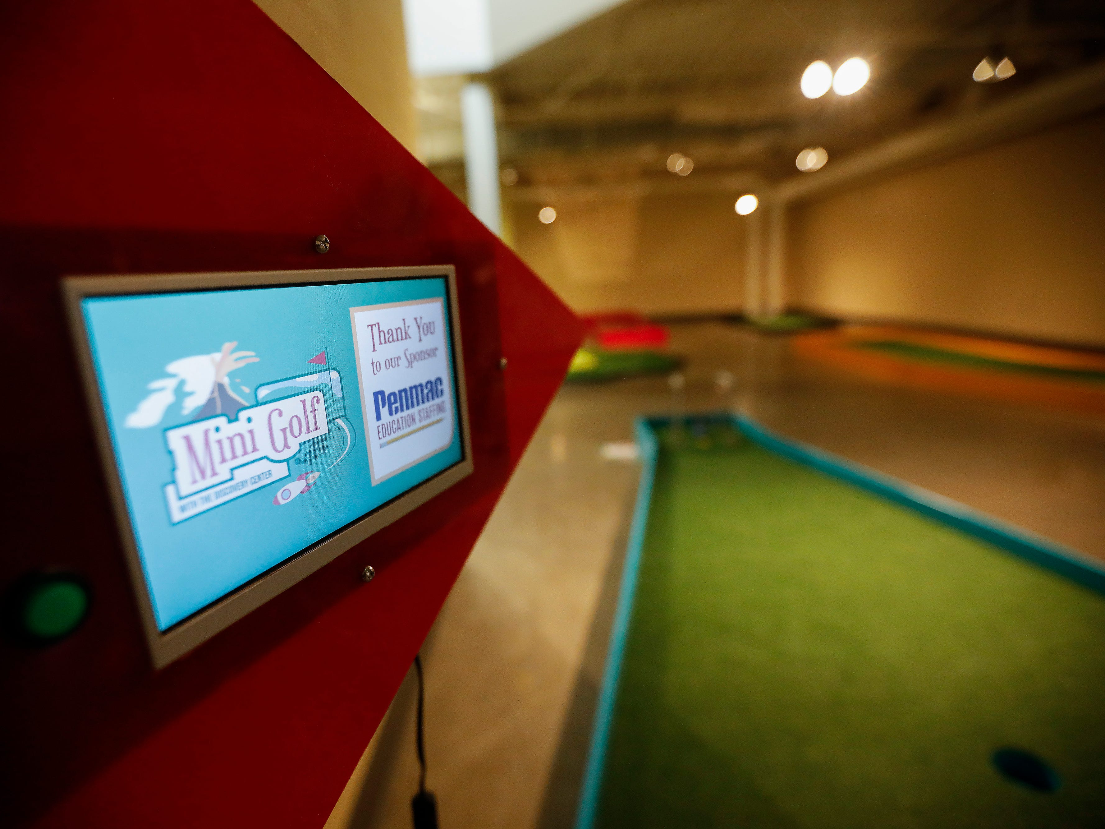 Small video screens at each hole of the new 9-hole indoor miniature golf course at the Discovery Center will play a message from sponsors and deliver a science lesson. The new exhibit opens to the public on Sunday, March 31, 2019.