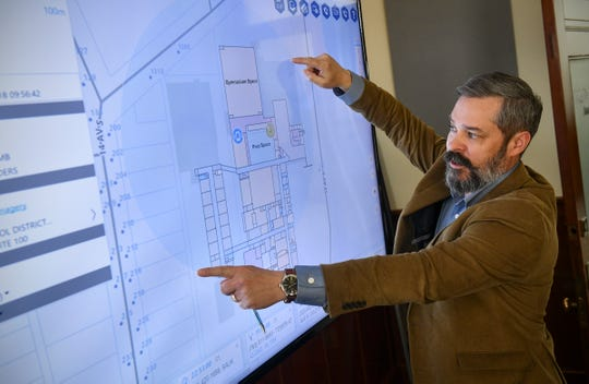 John Brosowsky, vice president of innovation, talks about details of a building mapping system for emergency calls Thursday, March 28, at GeoComm in St. Cloud.