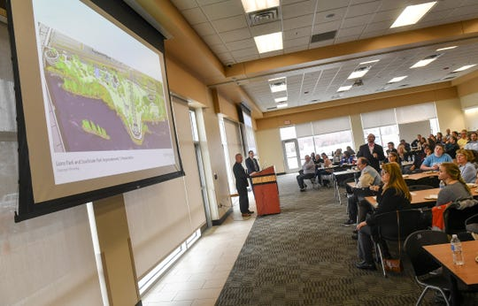 People watch as renditions and plans are shown for Lions and Southside park improvements during a State of the City presentation Thursday, March 28, at the Sauk Rapids Government Center.