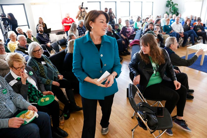 In this March 17, photo, Democratic presidential candidate Sen. Amy Klobuchar, D-Minn., speaks during a meet and greet with local residents in Cedar Rapids, Iowa.
