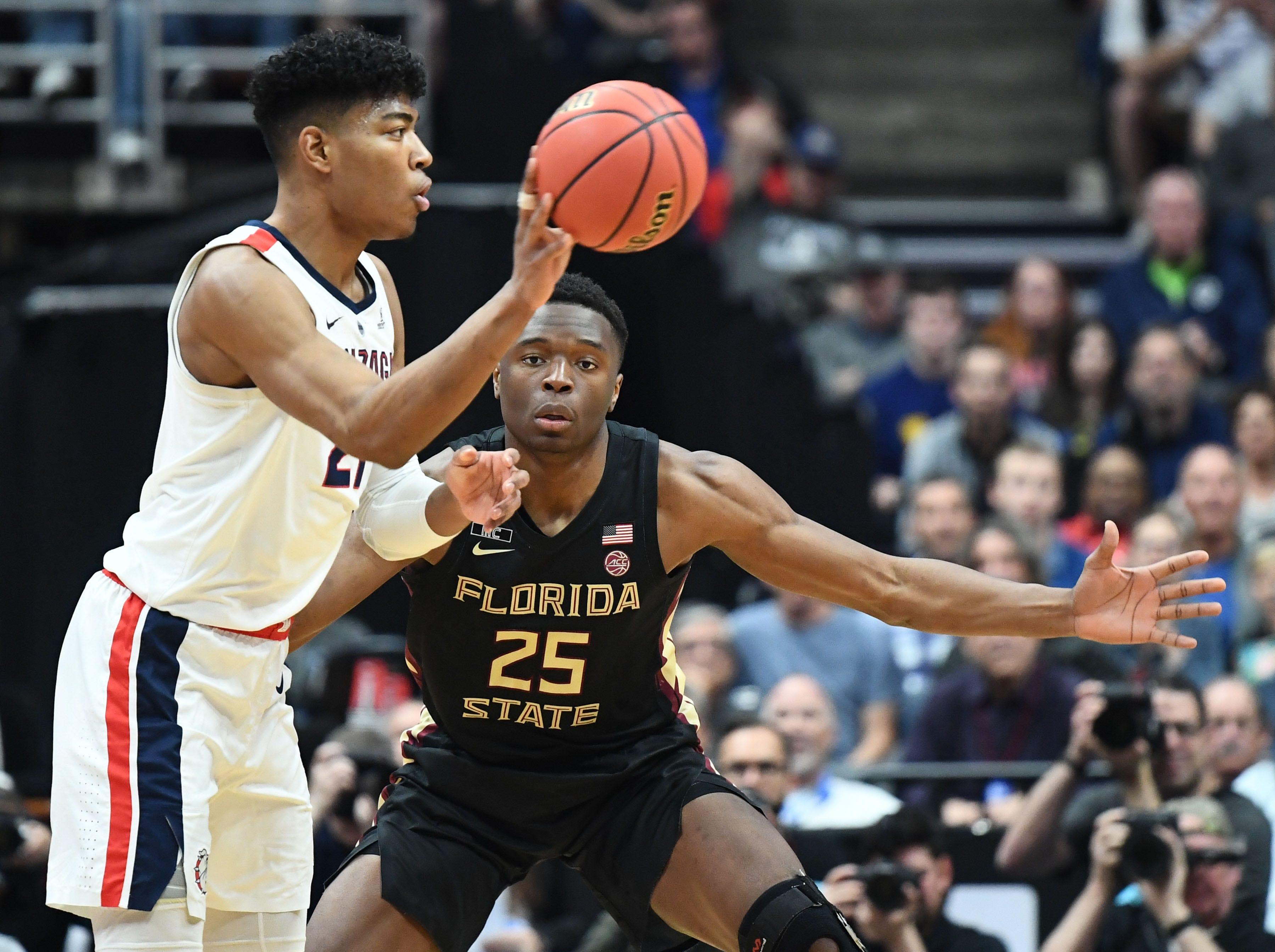 March 28, 2019; Anaheim, CA, USA; Gonzaga Bulldogs forward Rui Hachimura (21) passes against Florida State Seminoles forward Harrison Prieto (35) during the first half in the semifinals of the west regional of the 2019 NCAA Tournament at Honda Center. Mandatory Credit: Robert Hanashiro-USA TODAY Sports
