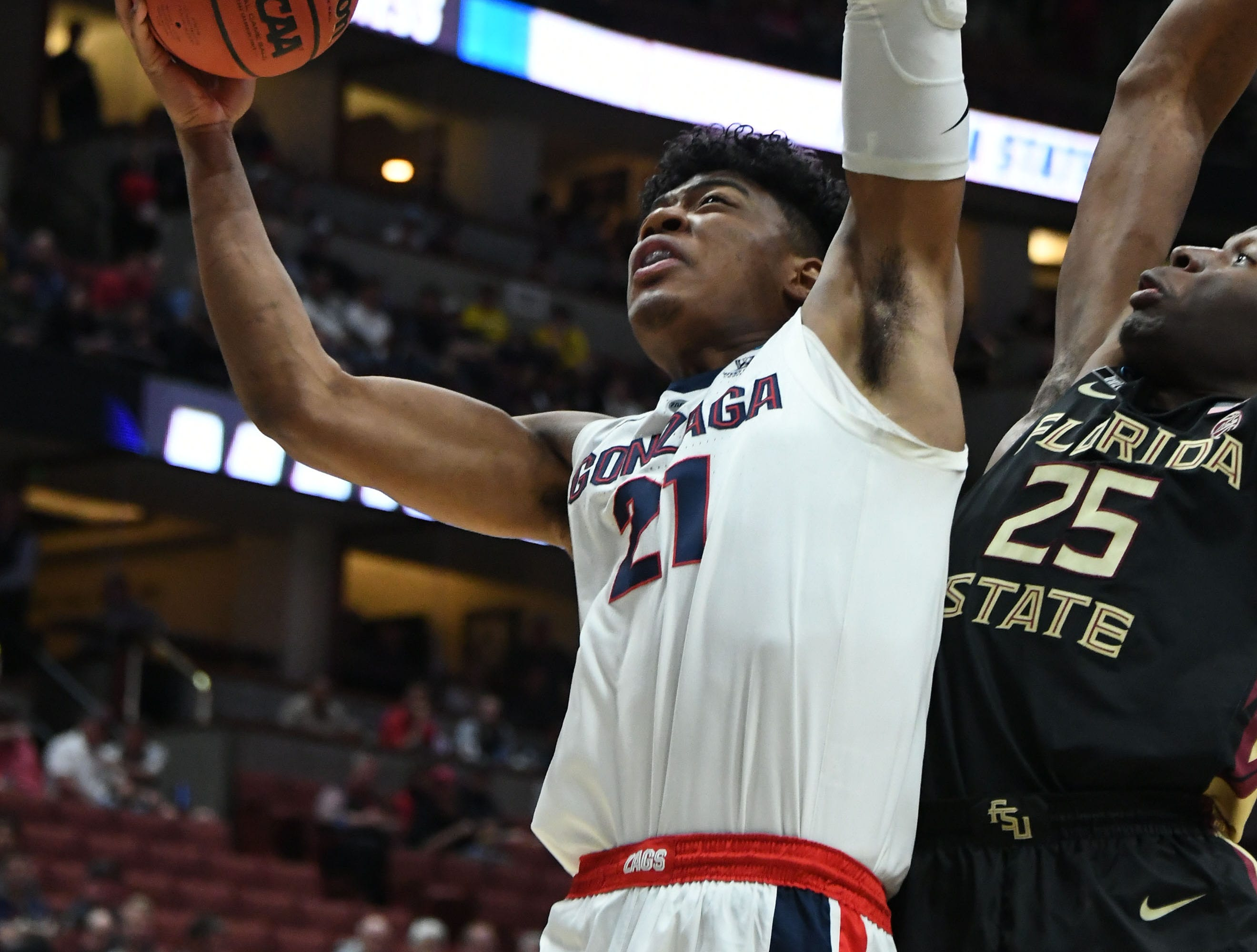 March 28, 2019; Anaheim, CA, USA; Gonzaga Bulldogs forward Rui Hachimura (21) moves to the basket against Florida State Seminoles forward Mfiondu Kabengele (25) during the first half in the semifinals of the west regional of the 2019 NCAA Tournament at Honda Center. Mandatory Credit: Richard Mackson-USA TODAY Sports