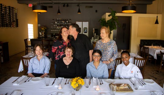 "William Lawson and his wife Holly, with his mother, Regena at right. Seated, from left: Natalie Carballo, Rebecca ""Mimi"" Johnson, Olivia Brevatt and Erin Wallace at Mimi's Table restaurant at 1311 Miccosukee Road."