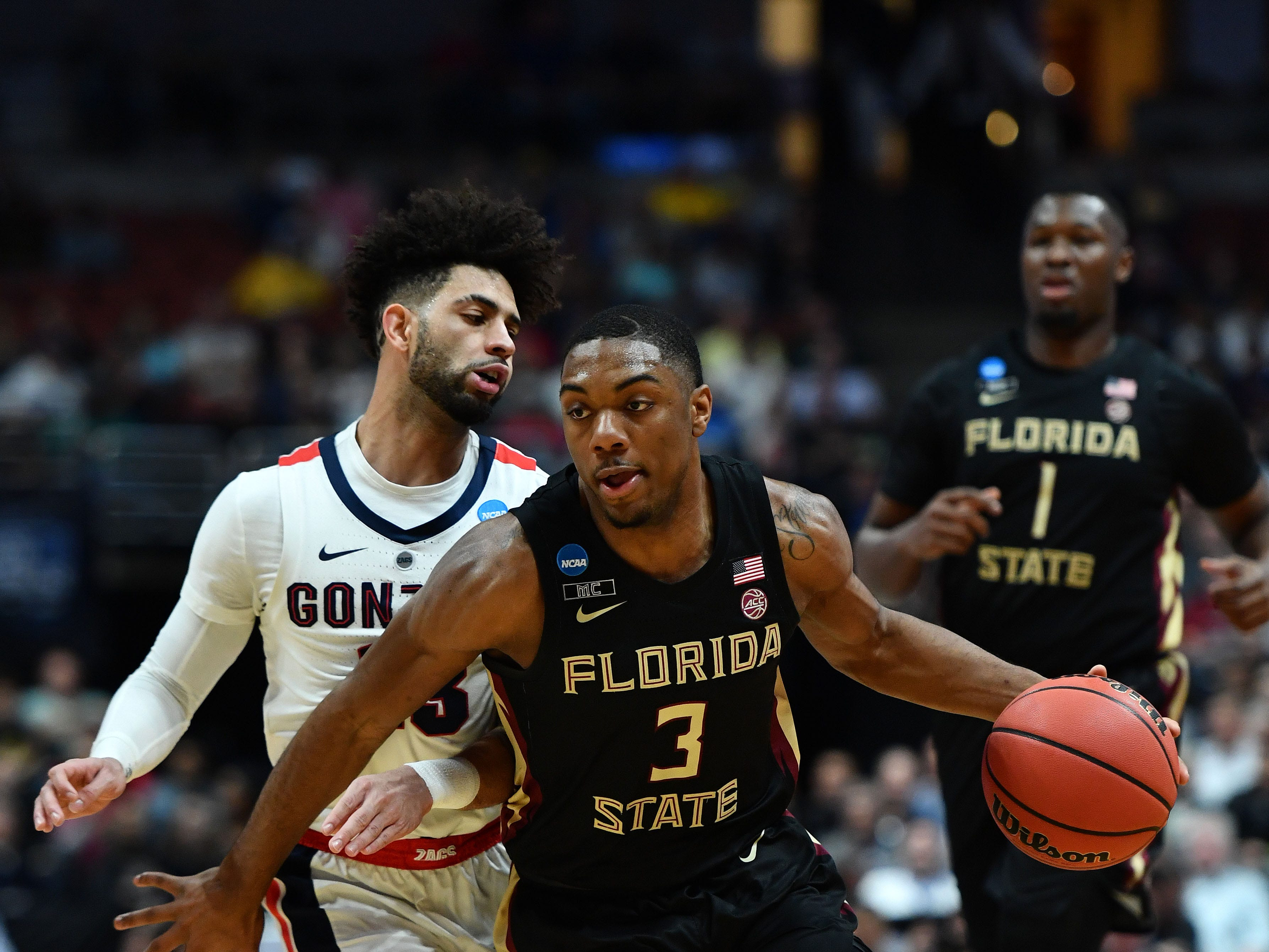 March 28, 2019; Anaheim, CA, USA; Florida State Seminoles guard Trent Forrest (3) moves the ball ahead of Gonzaga Bulldogs guard Josh Perkins (13) during the first half in the semifinals of the west regional of the 2019 NCAA Tournament at Honda Center. Mandatory Credit: Robert Hanashiro-USA TODAY Sports