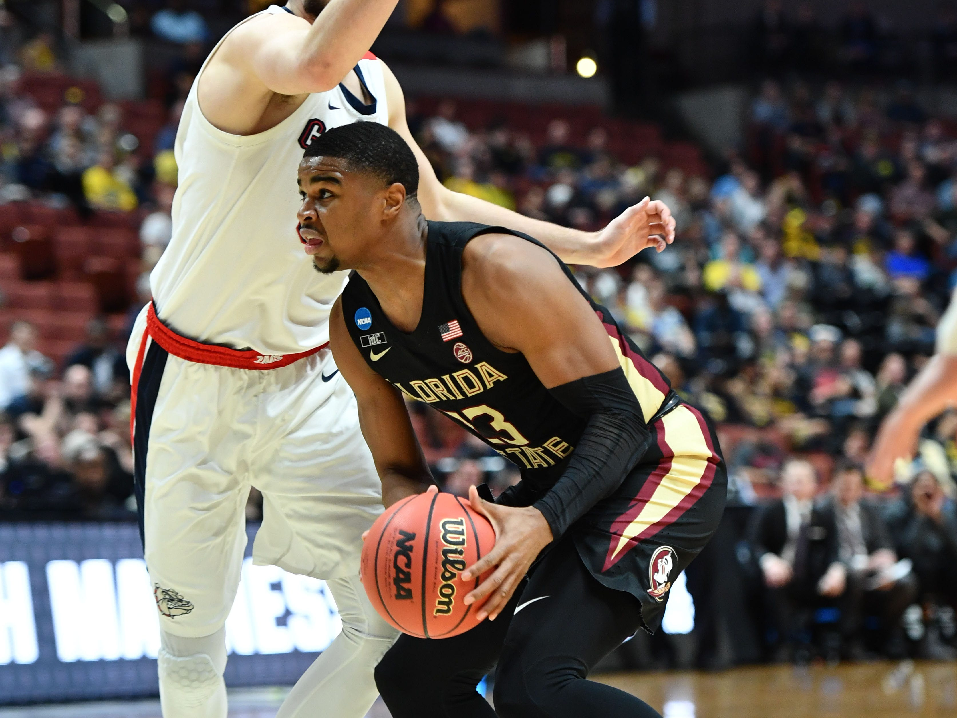 March 28, 2019; Anaheim, CA, USA; Florida State Seminoles guard M.J. Walker (23) moves the ball against Gonzaga Bulldogs forward Killian Tillie (33) during the first half in the semifinals of the west regional of the 2019 NCAA Tournament at Honda Center. Mandatory Credit: Robert Hanashiro-USA TODAY Sports